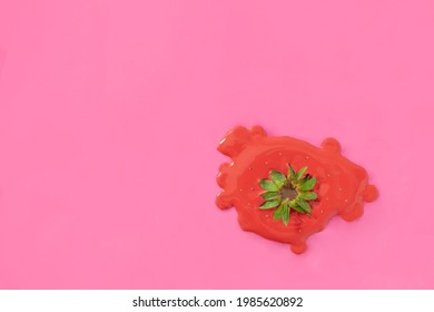 Red paint with green strawberry stem on pink background. Minimal cuisine concept. Creative food idea with copy space. - Shutterstock ID 1985620892