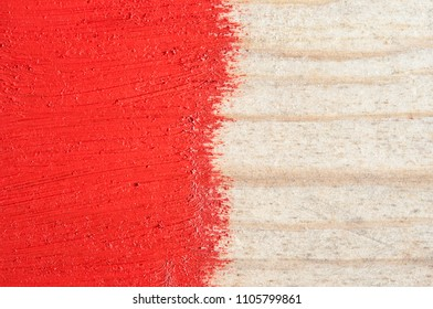 red paint on old wooden background