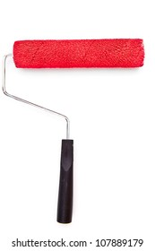 Red paint roller on white background