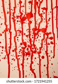 red paint splattered on white paper