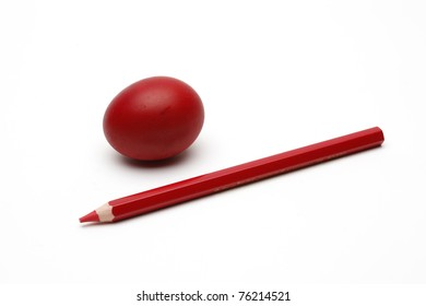 Red painted egg and crayon