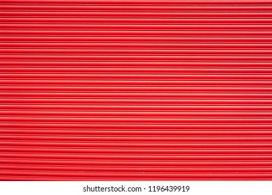 Red painted shutter or roller blind
