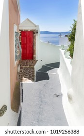 Red painteddoor on street of Thira, Santorini Island, Greece