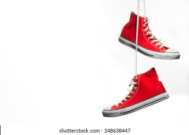 Sneakers+hang+on+laces Stock Photos, Images \u0026 Photography