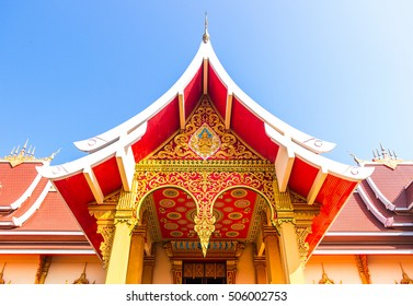 Red palace near Pha That Luang golden stupa in Vientiane, Laos capital
