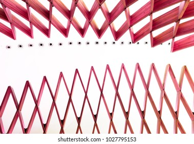Red pantograph object on white background - abstract