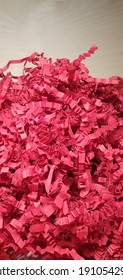 Red paper box filler. Gift wrapping. Red shavings for gifts.
