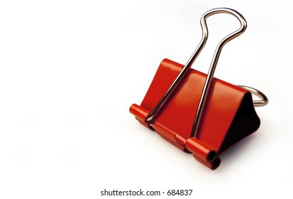 Red paper clip on a white background.