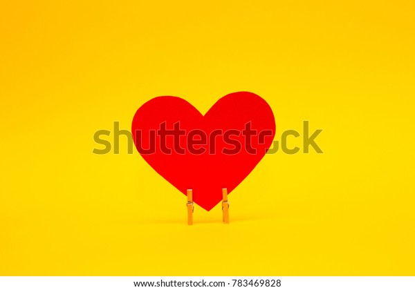 Red paper heart on yellow background. Happy Valentines Day background. Love concept