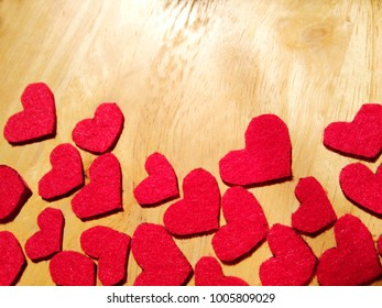 Red paper hearts shape on wooden background.Happy Valentines Day concept.Copy space