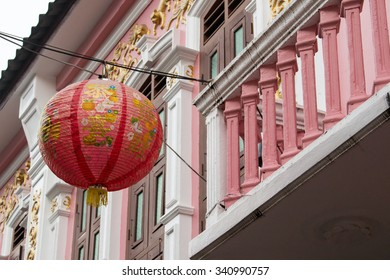 Red paper lantern in front of pink house in Phuket Old Town, Tha