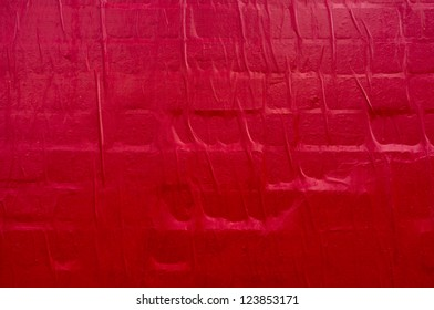Red paper on the wall
