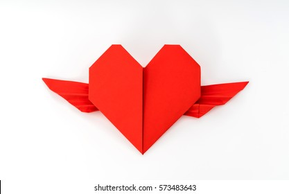 Red paper origami heart with wings on white background