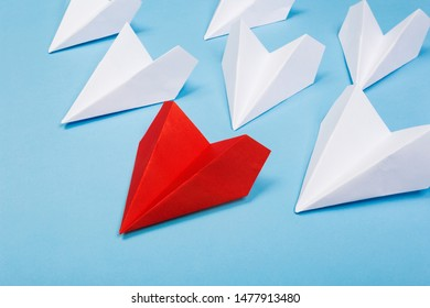 Red paper plane are different from others on blue background. Think different. Business for innovative, solution concepts