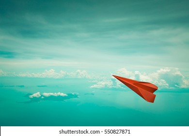 Red paper plane flying on clear sky  background,Copy space, Business concept.