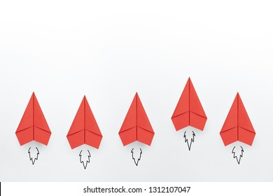 Red paper planes on white background. Business competition concept.