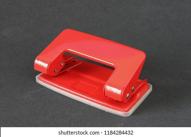 Red paper punch on a black background