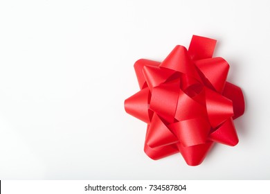 Red paper ribbon tie, Christmas gift packaging decoration, isolated on white background.