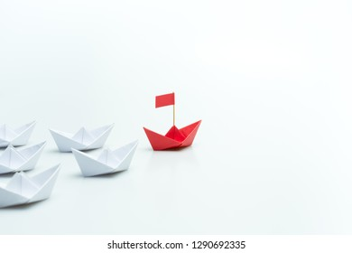 Red paper ship leading among white on white background, Leadership concept