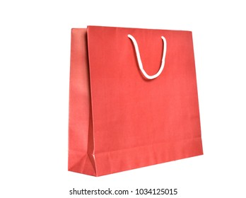 red paper shopping bag with handle made by white rope isolated on white background