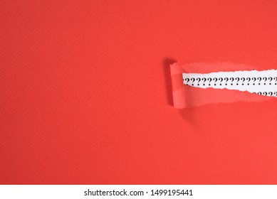 red paper teared revealing question mark on white paper. concept of FAQ, Q&A, search, riddle information and questions