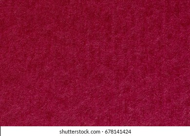 Red paper texture background, vertical stripes. High resolution photo.