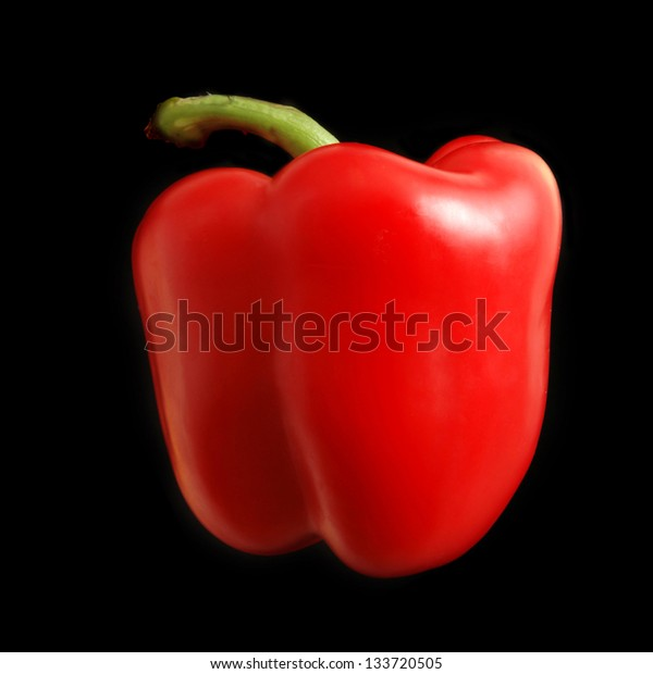 red paprika isolated on black background