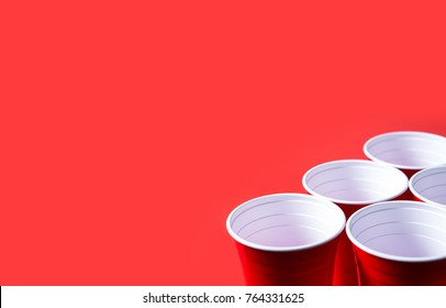 Red party cup and beer pong tournament background template. Alcohol containers with negative copy space.