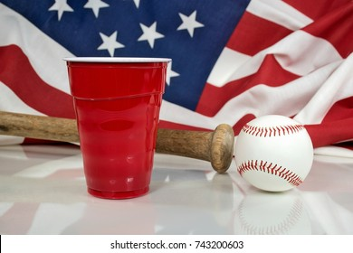 red party cup with wooden bat and baseball with American flag background