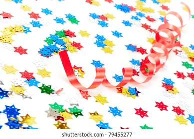 Red party decoration and confetti isolated on white background