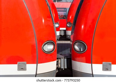 red passenger trains close up background