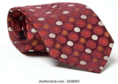 A red patterned silk tie