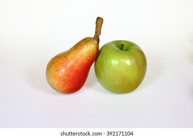 Red pear and green apple isolated on white