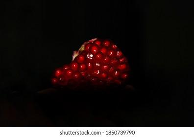 Red Peeled Pomegranate on Black Background