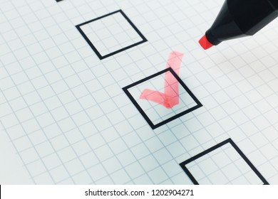 The red pen check point in black box on paper.