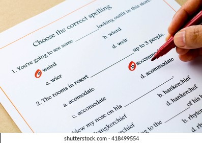 red pen marked on multiple choices on english spelling vocabulary test