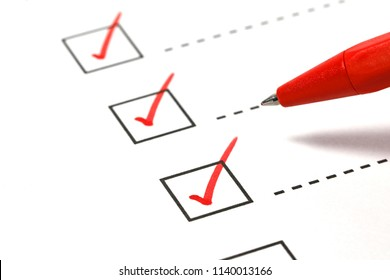 Red pen marking on checklist box.