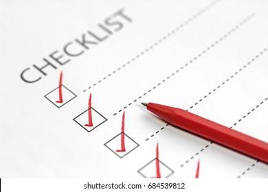 Red pen marking on checklist box.