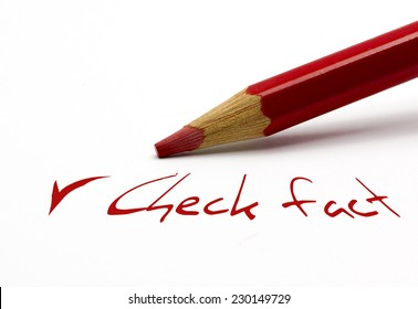 Red pencil - check fact with tick