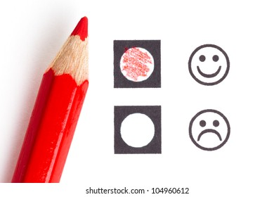 Red pencil choosing the right smiley (mood)