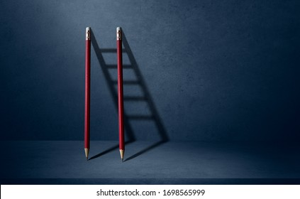 Red pencil on wall have a stairs shadow is shape. concept of effort business to be successful. Stairway to light for background.
