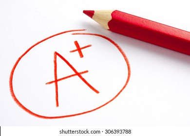 Red Pencil and A Plus Grade Mark
