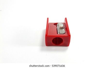 Red pencil sharpener isolated on white background