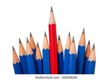 Red pencil standing out from a bunch of blue pencils isolated on white background