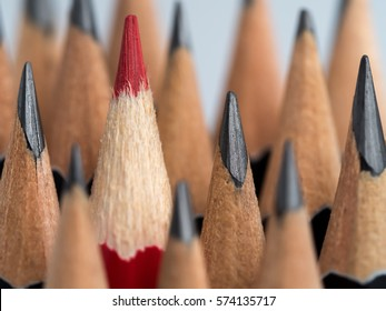 Red pencil standing out from crowd of plenty identical black fellows on grey background. Leadership, uniqueness, independence think, initiative, strategy, dissent, business success concept