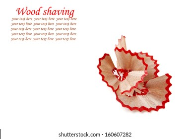 Red pencil and wood shavings isolated on white background