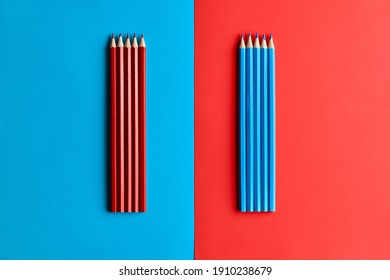 red pencils on a blue background blue pencils on a red background