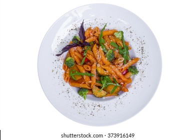 Red penne pasta with tomato sauce, broccoli, eggplant, paprika and parmesan cheese, top view, isolated