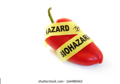 Red pepper with bio-hazard tape. Genetically modified food or pesticide concept