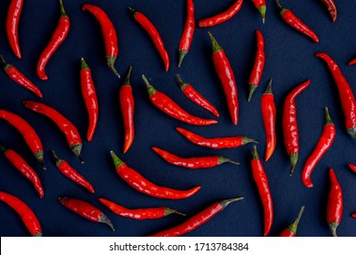 Red pepper chili background pattern. Dark background. Sauce hot pepper chili, habanero, red.